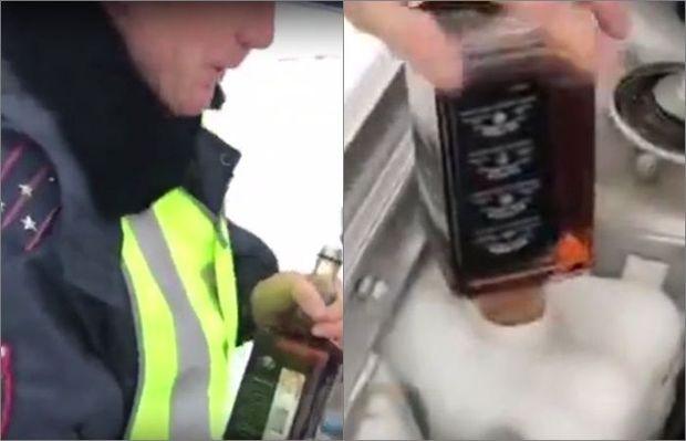 Yol polisləri DYP maşınına su əvəzinə viski tökdülər - VİDEO
